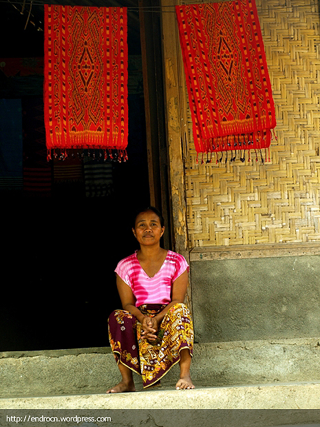 Sasak woman in fron of her house